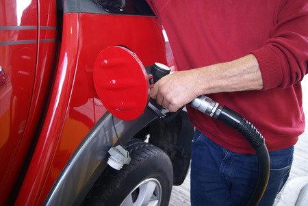 refueling: refueling a car at a filling station