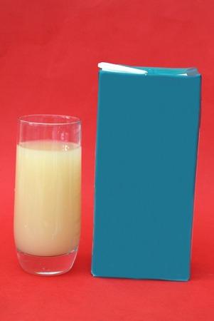 grapefruit juice: Glass and package of grapefruit juice drink