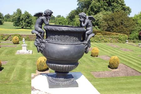 Sculptured vintage vase. Urn with cherub sculptures