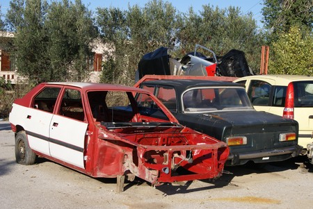 dismantling: scrapped cars. vehicle recycling. scrapyard. wrecking yard