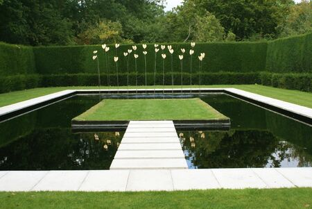 garden fountain: Fountain in a garden. Fountain in the shape of lilies