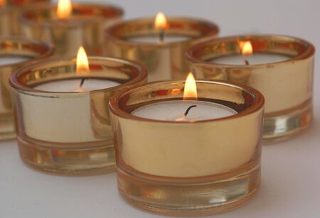 lighted: Lit Candles Set. Glowing Candles. Lighted Candles Stock Photo