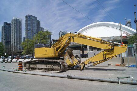 road work: Road work digger vehicle. Hydraulic excavator