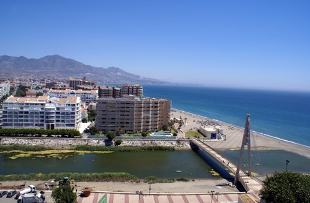 pedestrian bridge: Aerial view of a pedestrian bridge over a river in Costa del Sol, Fuengirola, Malaga Province, Spain Stock Photo