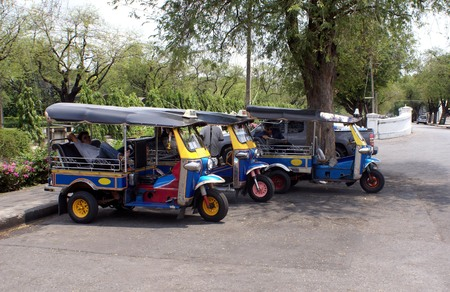 autorick: Tuk-tuks. Taxis. Auto rickshaws. Rickshaws. Three-wheelers in a car park