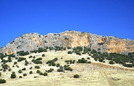 cliff face: Cliff face. Mountain. Mountain with a cliff, Malaga, Spain