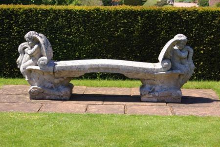 cherubs: stone seat. stone bench