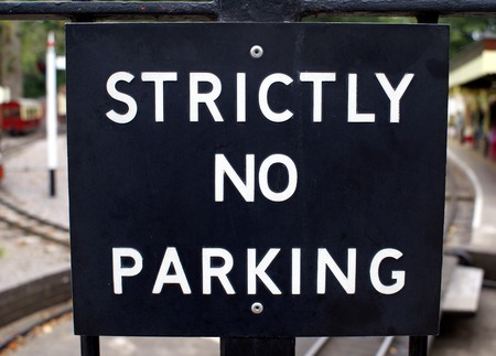 strictly: strictly no parking sign