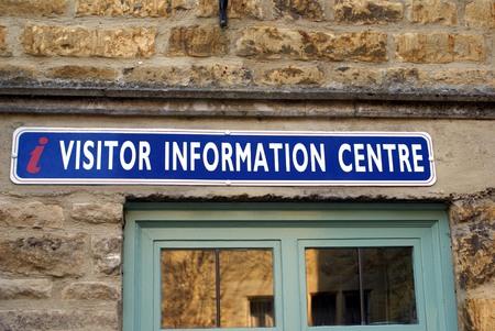 visitors area: i visitor information center sign. information centre
