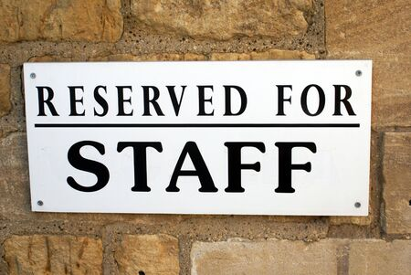 reserved sign: reserved for staff sign Stock Photo