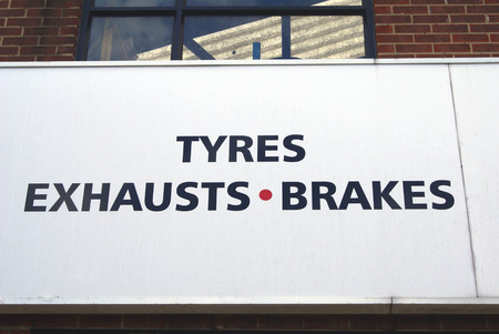 body shop: Tyres, exhausts, and brakes sign. garage. body shop for cars or vehicles