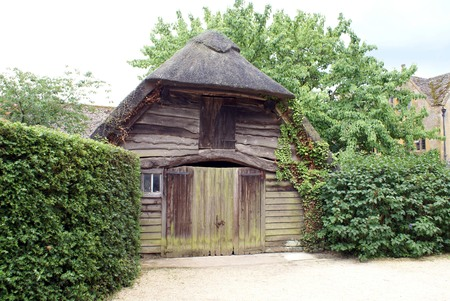 thatched roof: wooden barn with a thatched roof. hut