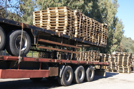 on the skids: Trailers with wooden pallets Stock Photo