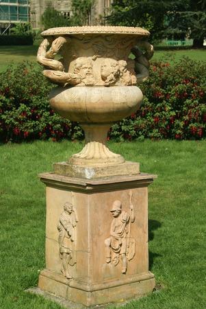 urn: vintage urn or vase on a pedestal