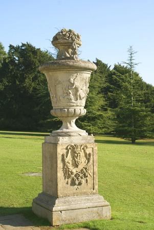 urn: sculptured vase or urn on a pedestal Stock Photo
