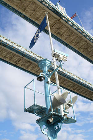 acoustic systems: CCTV camera, public loudspeakers, spotlights, & flags, The Tower Bridge, London, England