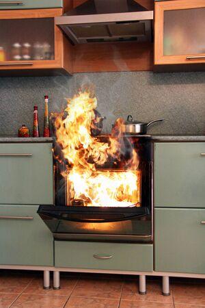Fire in the house in the kitchen. Home insurance Archivio Fotografico