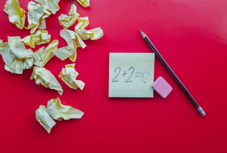 Yellow sticky note reminder on red background with pencil, empty place for text