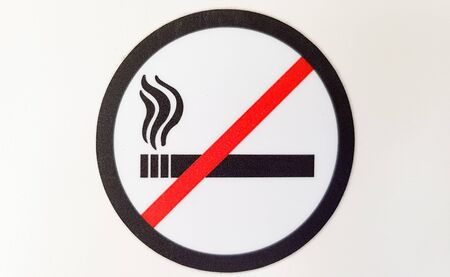 Round red and black no smoking sign, sticker in a public place on a white background. Stok Fotoğraf