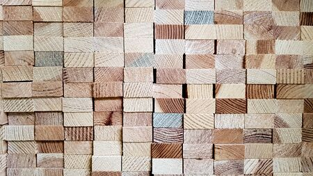 Wood texture background. Lumber industrial wood texture. End end made from machined wooden beam. Glued pine timber beams for wooden windows closeup. Imagens