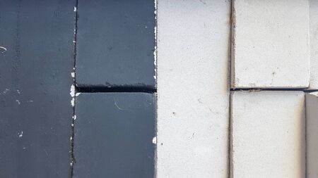 black and white bricks piled equally in a pile. Close-up. Black-white stone background. 스톡 콘텐츠