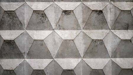 Background texture of an old gray concrete fence with a square pattern. Concrete wall. Soviet concrete texture fence, diamond-shaped fence. 写真素材