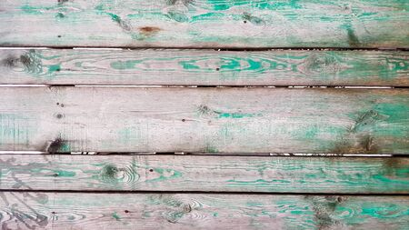 Background picture made of old green wood boards. Texture wall wooden trendy green background. Background of the tree, dark color boards, free without objects. Billet wood horizontal boards wall