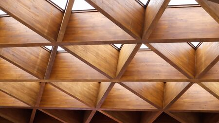 Luxurious geometric wooden triangles in construction. The concept of modern architecture, design and interior. Wood background. Modular canopy or roof