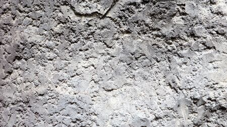 Stone rock texture or background. Gray rocky uneven surface, natural seamless backdrop for design. Copy space.