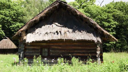 Ukraine, Kiev - June 11, 2020. The old house of peasants in the museum Pirogovo. National Museum of Folk Architecture and Everyday Life of Traditional Folklore Houses of Different Regions of Ukraine. Éditoriale