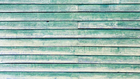 Natural texture of natural green wood. Green wooden background. The vintage panel is beautifully designed as a wall for interior and exterior design