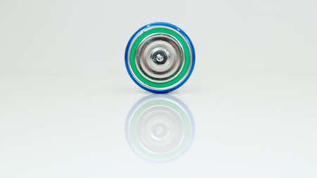 Large battery type D or C cell on white background with reflection. View of a metallic alkaline battery with copy space. Mandatory processing. Standard-Bild
