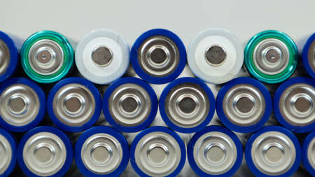 Lots of AA and AAA alkaline batteries on a white background. Ecological recycling concept. The terminals of the disposable batteries are close together and form a beautiful backdrop. Energy source Foto de archivo
