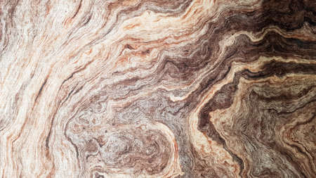 The surface of Sandstone with wavy brown veins. Sulfide agate texture. Wide image of brown natural stone texture Sphalerite. Beautiful wavy pattern of cut of Schalenblende stone close-up.