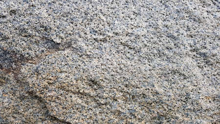 stone texture or background. Coarse cracked stone structure of the face. empty gray stone texture or background. Stockfoto
