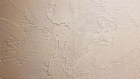 Light textured plaster as a background. Decorative plaster effect on wall. Textured background. Decorative plaster walls, external decoration of facade. Texture of beige