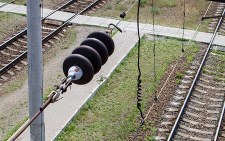 A railroad overhead power line component along a track with a rail electrification system that supplies power to an electric train. Overhead line wire on a rail track