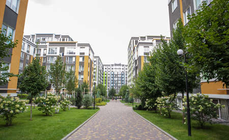 Apartment buildings in a new modern residential complex. Modern architecture. Social housing. The territory of a new residential area with tall buildings and large landscaping