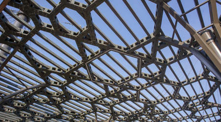Pergola canopy, structural elements. An architectural structure of repeating arches to protect visitors from the sun. Renewed entrance lobby in Kiev on Trukhanov Island after reconstruction