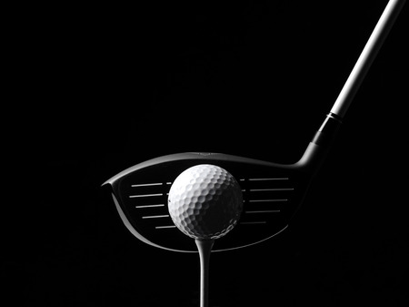Golf Wood with a Golf Ball and Golf Tee Isolated on Black photo