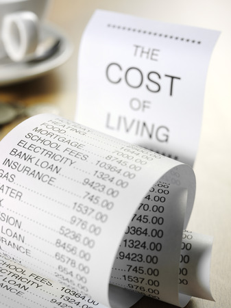 printout: Figures for the cost of running home finances on a paper printout. Stock Photo