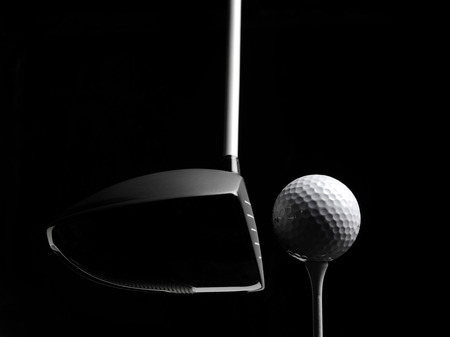golf ball on tee: Golf wood with a golf ball and golf tee Isolated on black Stock Photo