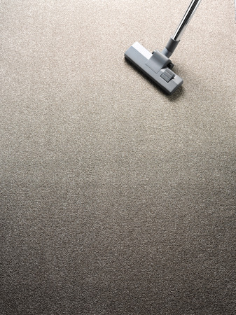 dirty carpet: Vacuum cleaner on a carpet with copy space