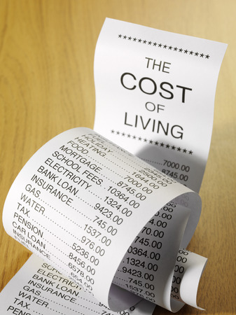 Cost of living figures on a paper printout