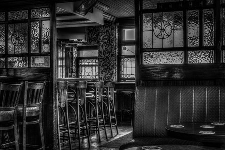 Pub black and white seating area Editorial