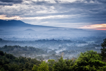 jogjakarta: Sunrise over a valley with Borobudur temple in the distance