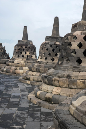 bell shaped: Bell shaped stone carvings at the top of Borobudur temple, Indonesia