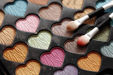 heart shaped: Close-up of eyeshadow heart shaped palette with applicators.