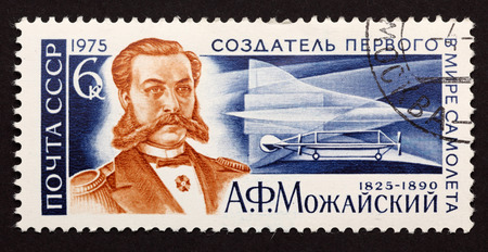 first plane: USSR postage stamp Alexander Fedorovich Mozhayskiy. Creator of the first plane in the world.Alexander Fedorovich Mozhayskiy was a Russian naval officer, aviation pioneer, researcher and designer of heavier-than-air craft.USSR postage stamp 1975 year. Editorial