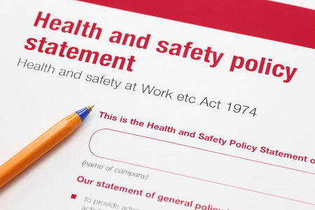 policy document: Health and safety policy statement and ballpoint pen. Stock Photo